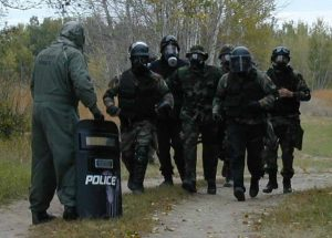 Team Runs Gas Mask at Tactical EMS School Essentials for Tactical Medic Certification Paramedic Emergency Medical by Tactical Specialties and Todd Burke in Columbia MO