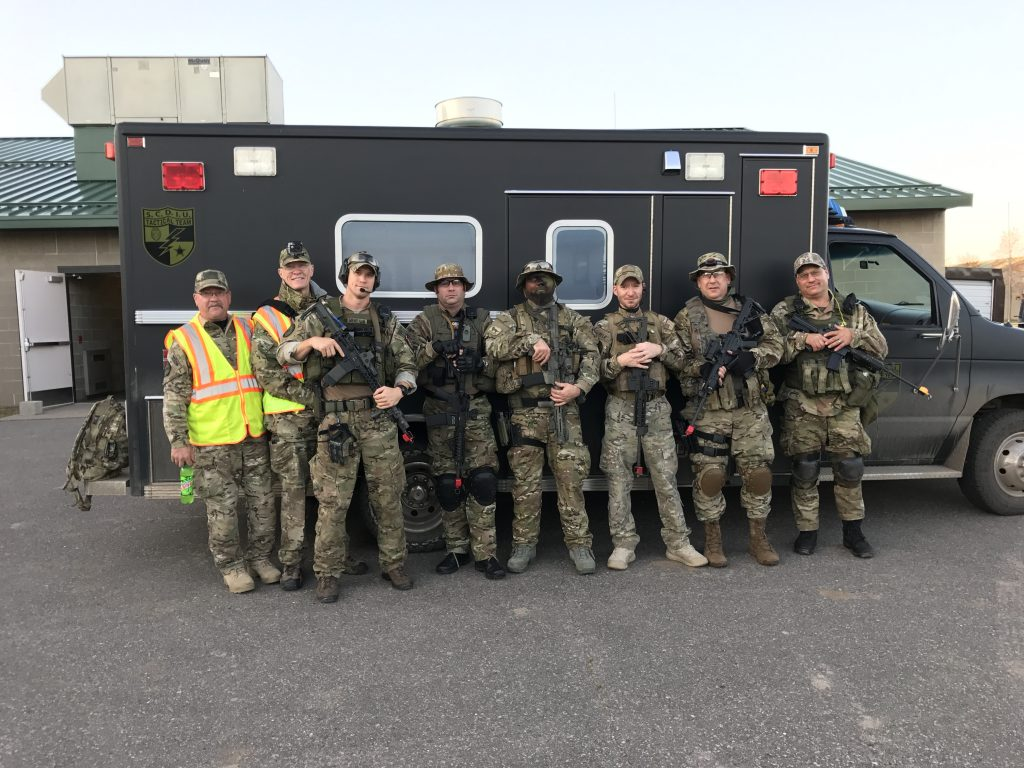 Experienced coaches and tactical operators serve as team leaders for medics in the tactical ems school at Camp Ripley Minnesota September 2017 note the two in yellow vests who act as medical monitors to specifically support the medics decision-making and medical skills during the operation.