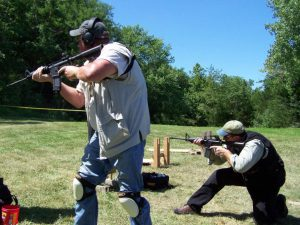 AR101 AR-15 M4 Rifle Class led by Todd Burke of Tactical Specialties 1 men shooting AR15s having fun how rifle works Green Valley Rifle and Pistol Club in Hallsville Missouri