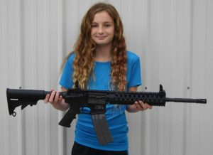 AR101 AR-15 M4 Rifle Class led by Todd Burke of Tactical Specialties 2 girl holding gun operator Green Valley Rifle and Pistol Club in Hallsville Missouri